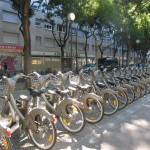 Paris has the world's second largest bicycle sharing system.  There are some 20,000 of these bikes throughout the city.  You buy a 'pass', and then pick them up, and drop them off at any of the many bike parks.  More info here: http://en.wikipedia.org/wiki/Bicycle_sharing_system