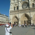 A new breed of tourist in front of the Notre dame - the IPad tourist.  SLR cameras are sooo last year.