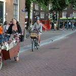 Amsterdamians cart around everything on their bicycles, including 3 kids, five dogs, and ikea book shelves
