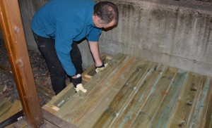 Putting into place the last decking timber.  Note, we were one short.