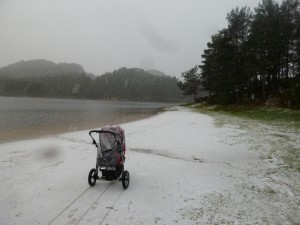 At the lake.  It turns out pushing a stroller in the ice is actually quite challenging as brakes are rendered useless, and it becomes a sled.  I googled chains for stroller tyres, but the google seemed to suggest there was no need because 'who would want to go out in the ice and snow, anyway'.