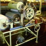 Carding machine: aligns fibres and rids wool of debris